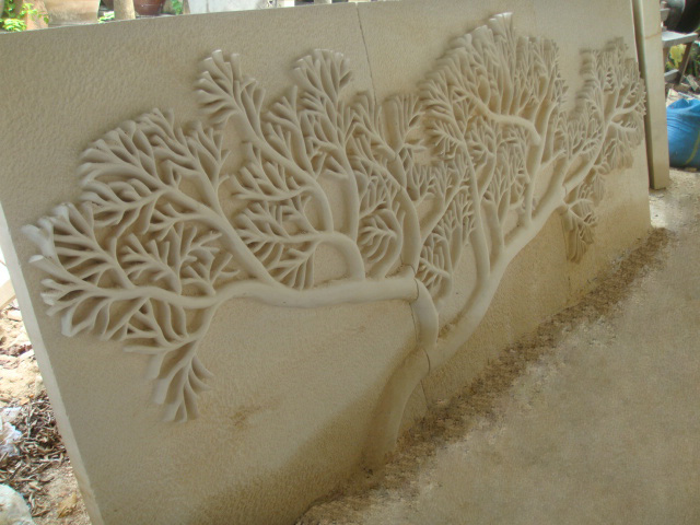 Stone wall carving p pottery bali